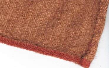 Red tablet woven band as the hem finishing.