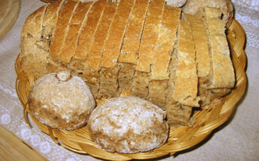 Assortment of baked bread in basket.